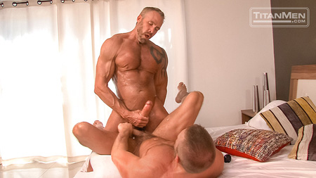 Hung muscle Daddy pulling his huge cock out of the other man and cumming on him.