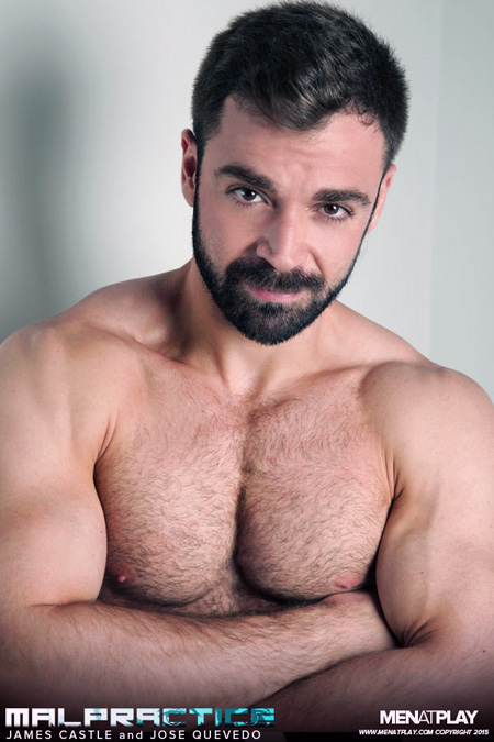 Bearded Latino muscle bear shirtless and showing off his huge arms.
