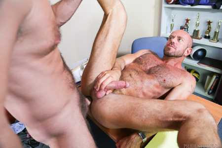 Hairy Coach fucking the male Principal on his desk.