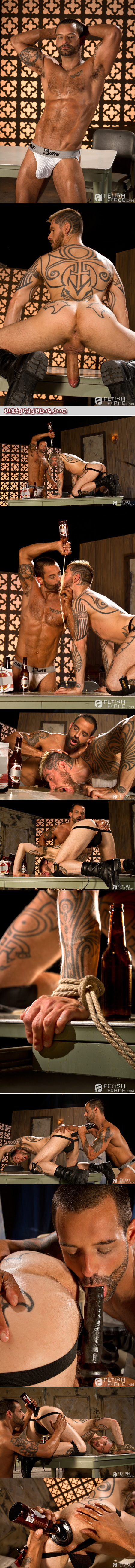 Heavily tattooed muscle stud receiving an ass funnel and beer enema.