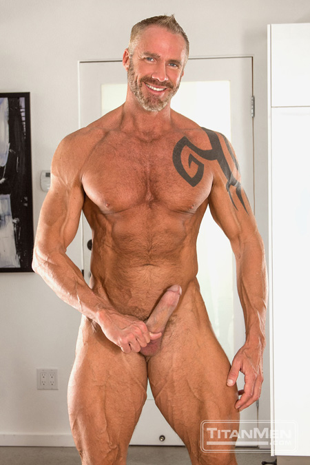 Dallas Steele, ripped muscle Daddy with a beard and hairy muscles.