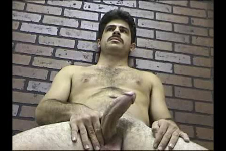Straight man with a seventies porn mustache showing off his large penis.