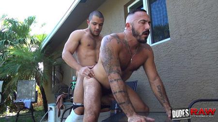 Latino muscle hunk fucking a hairy muscle Daddy bareback outdoors.