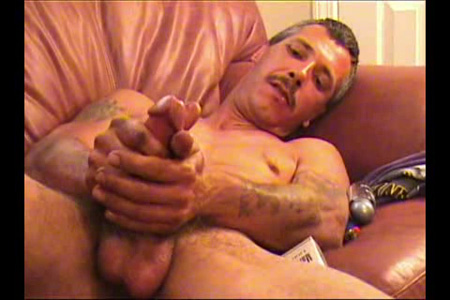 Mustachioed straight guy jacking his cock with both hands.