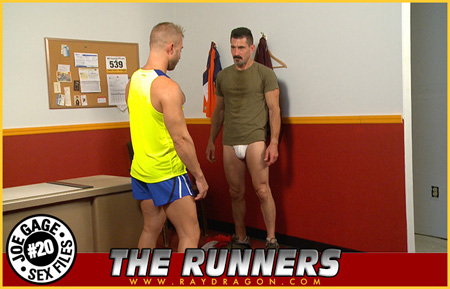 Mustache Daddy in a jockstrap with his male running coach checking him out.