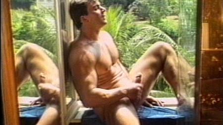 Bodybuilder Mr. Brazil masturbating in an open window.