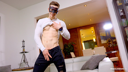 Young French Canadian muscle stud lifting his shirt and showing his ripped abs.