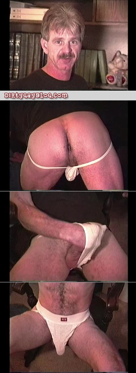 Mustachioed Daddy wearing nothing but an old jockstrap.