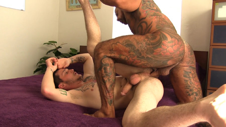 Tattooed Daddy barebacking a younger tattooed male.
