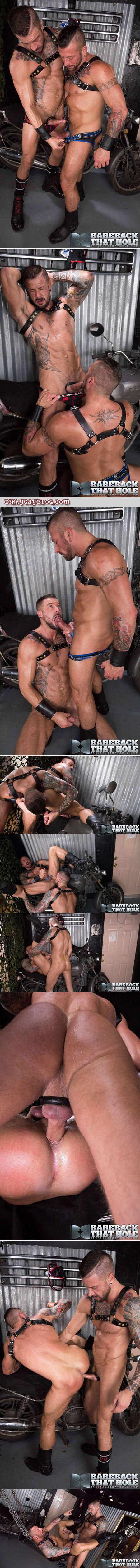 Heavily tattooed male couple fucking in a sling at the leather bar.