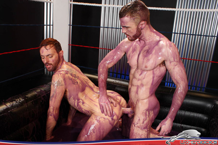 Ripped muscle stud fucking his wrestling partner in the ass in a bathtub of colored lube.