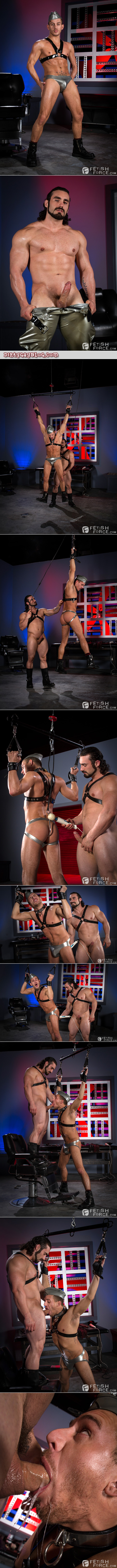 Men in rubber bondage using sex toys to dominate another man.