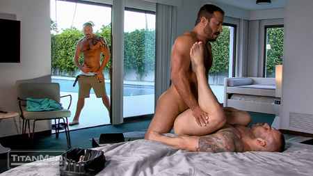 Male voyeur watching two muscular men having gay sex.
