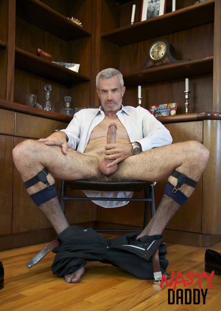 Hung Daddy businessman pulls his trousers around his ankles and sheer socks to show off his huge white cock.