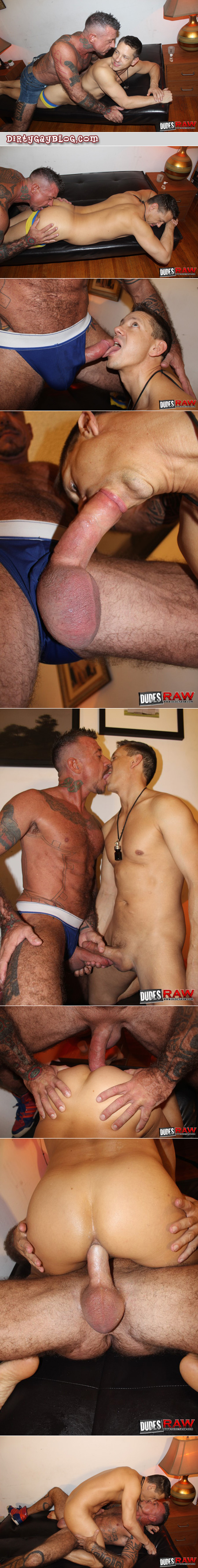 Heavily tattooed hairy muscle Daddy barebacking a younger man.