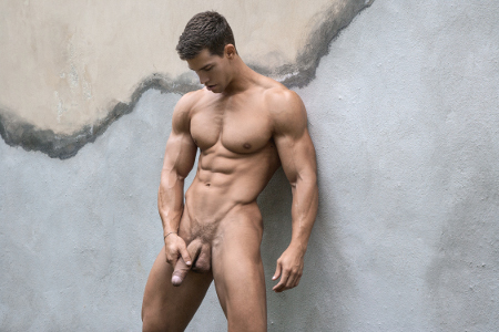 Hung muscle stud nude outdoors and stroking his giant veiny cock.