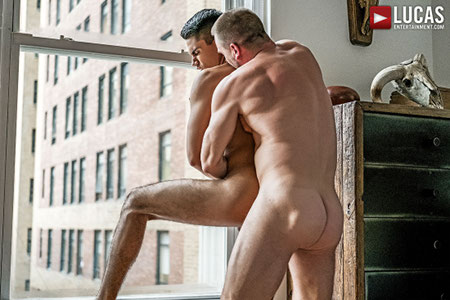 Muscle Daddy fucking his stepson in the window of his apartment.