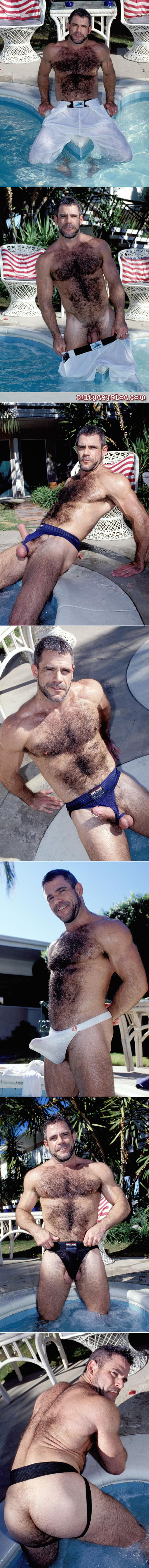 Hairy muscle Daddy wolf shows off his Prince Albert in skimpy wet underwear by the pool.