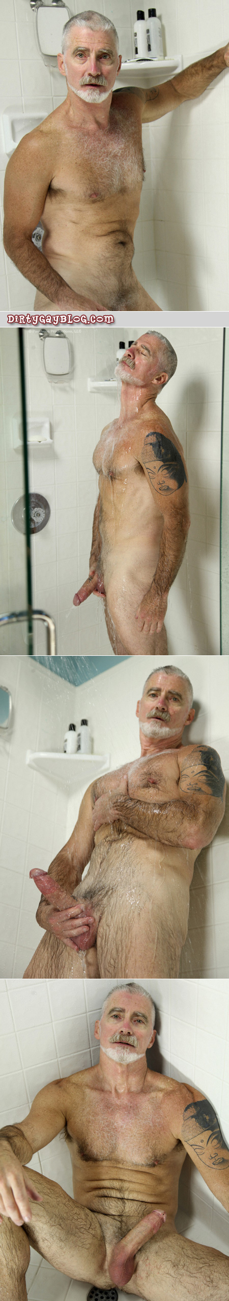 Fit, tattooed silver fox takes a shower and gets his Daddy cock stiff.