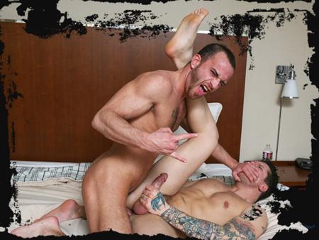Hairy, macho guy having rough gay sex with his horny, heavily tattooed friend.
