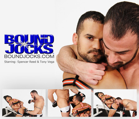 Hairy, muscular boxer ties the loser to a weight bench and immobilizes him with rope.