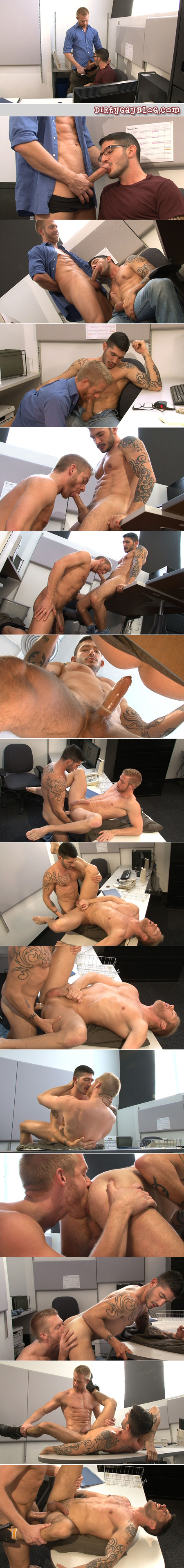 Tattooed guy in glasses blackmails a male office worker into having gay sex with him.