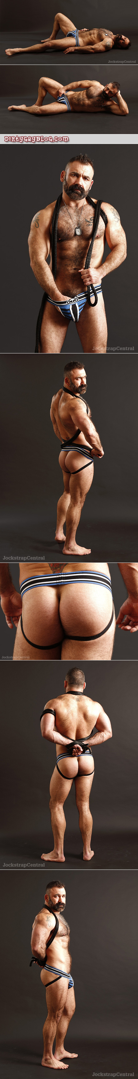 Beefy, hairy muscular mature Daddy barefoot and in nothing but a Nasty Pig jockstrap.