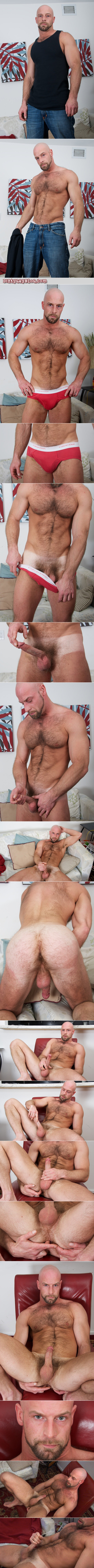 Bald, muscular Daddy with a hairy chest and back masturbates wearing red underwear.