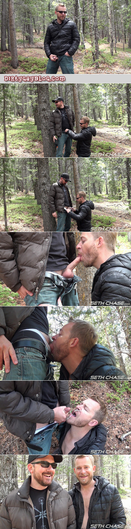 A bearded guy gives another bearded guy a cum facial in the woods.