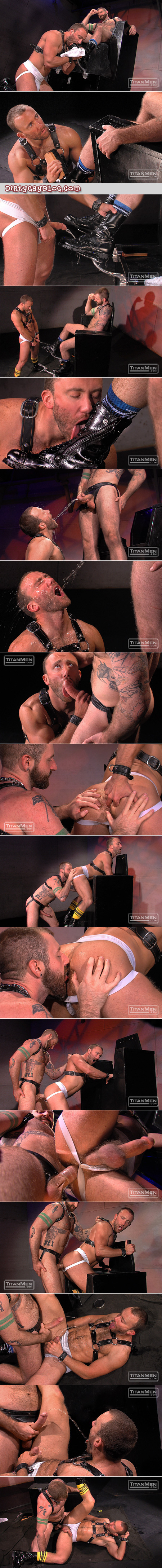 Leather boot black swaps piss with his bearded, heavily tattooed man he serves.