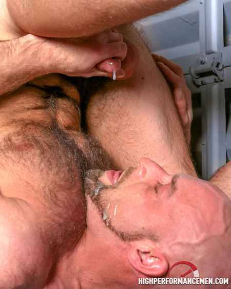 Mature, muscular stud lies upside down to shoot his load in his own bearded mouth.