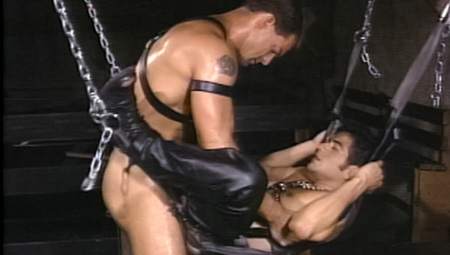 Macho leatherman fucking a guy in a sling in motorcycle boots.