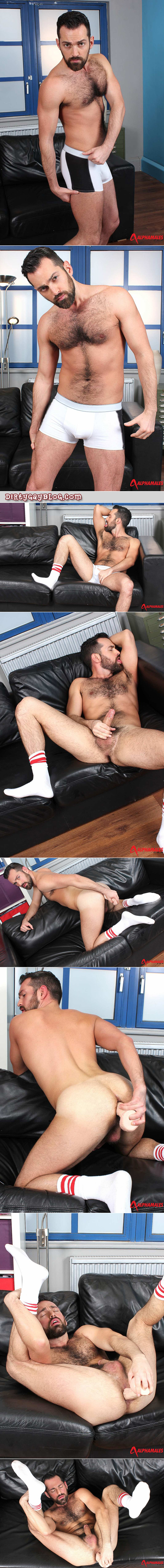 Muscle bear in white striped athletic socks and underwear jerking off with a veiny dildo in his ass.