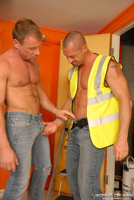 Beefy constructions workers with big bulges in their blue jeans.