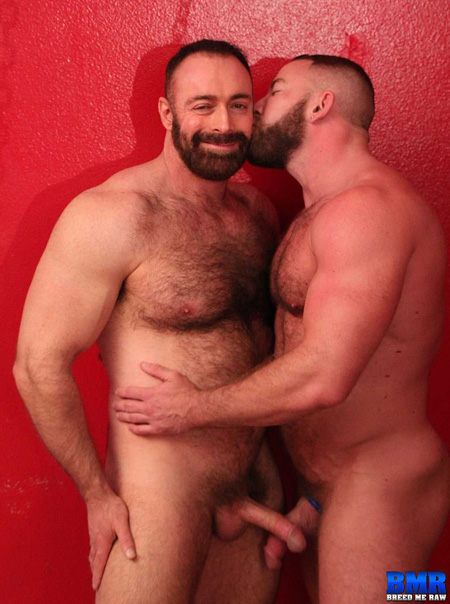 Beefy, hairy men with big dicks happily kissing.