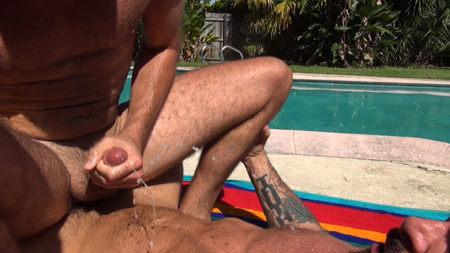 Cute bottom spraying his huge cum load all over his Daddy's furry muscular abs while he's got his dick up his ass.
