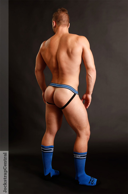 Muscle butt in a jockstrap with sports fetish athletic socks.