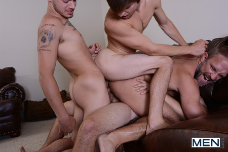 Stepfather receives three of his stepsons' cocks in his ass simultaneously.
