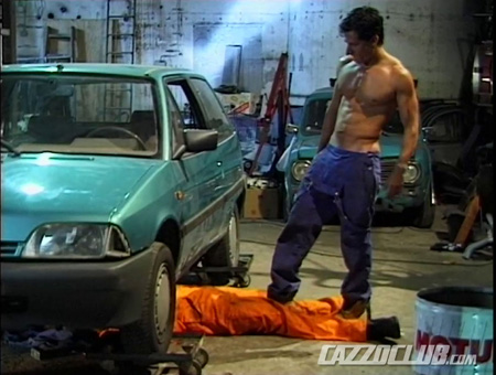 Muscular garage attendant groping a car mechanic while he's working.