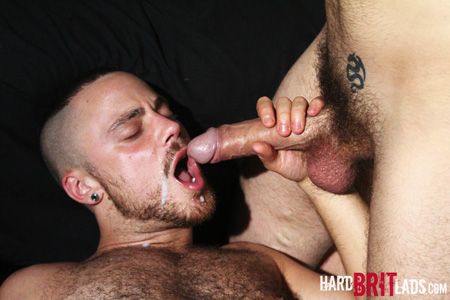 Adorable gay cub getting a cum facial from a guy with a huge uncut cock.