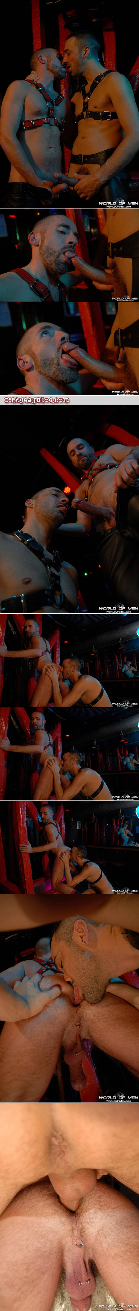 Leather men having sex in a gay bar while a male bartender watches from the shadows.