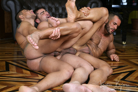 Beefy Latino men in a gay sex daisy chain.