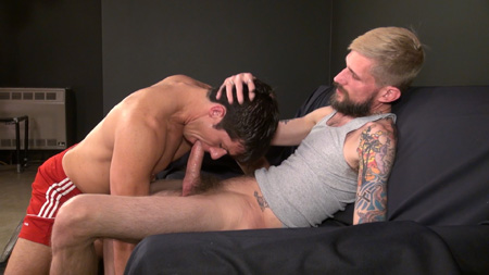 Thin, hairy blonde guy with a thick beard forces a smooth beefy jock to suck his dick.