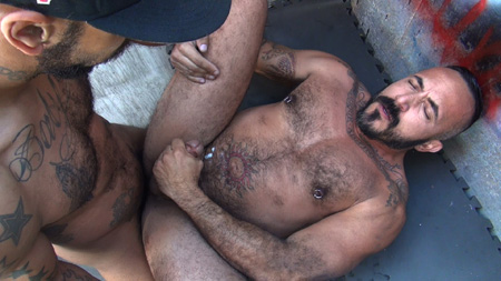 Hairy muscle Daddy shooting his load while he gets fucked bareback.