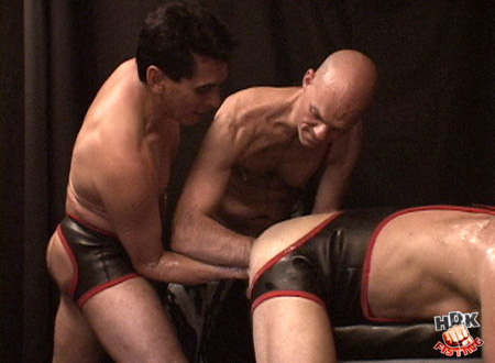 Double-fisting a Daddy in bottomless leather shorts.