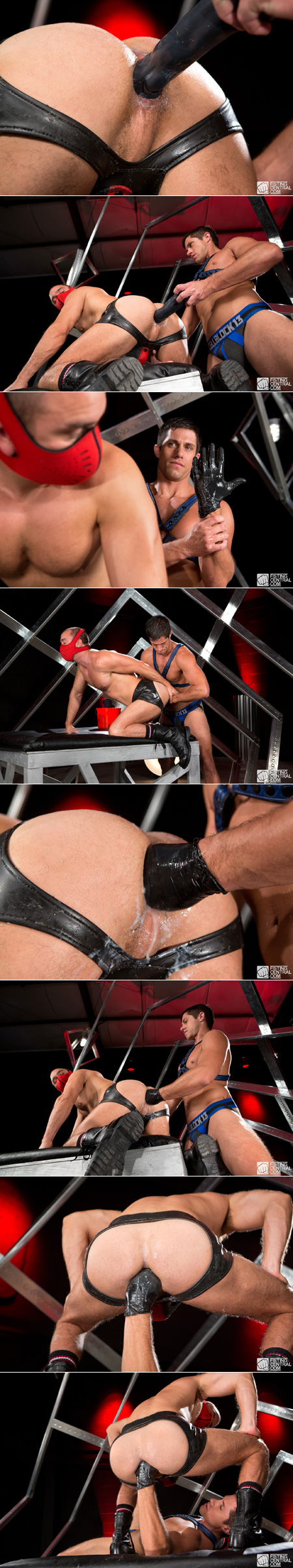 Man in a jockstrap and leather boots fisting another man on all fours on an elevated table.