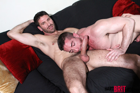 Hung, hairy hunk getting his huge uncut cock sucked by another hairy muscle stud.