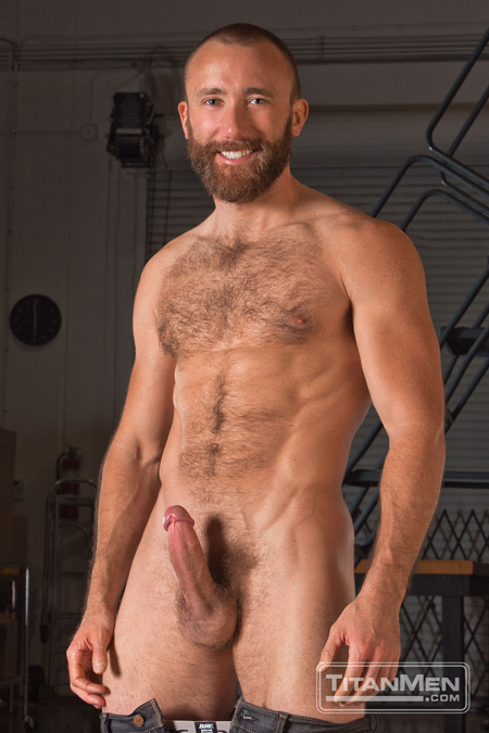 Bearded muscle hunk with his jeans and jockstrap pulled down and his hairy chest and hard-on exposed.