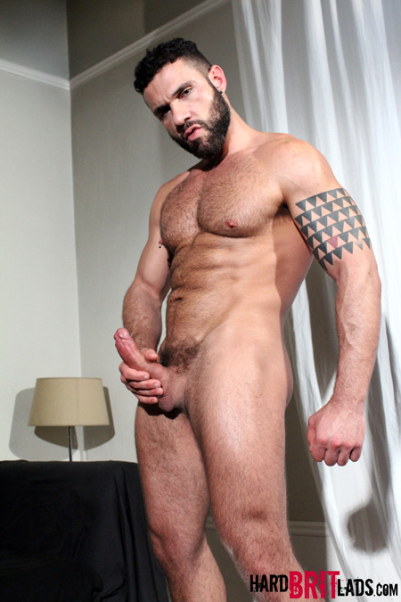 Hairy muscle stud with a thick beard and a huge erection.