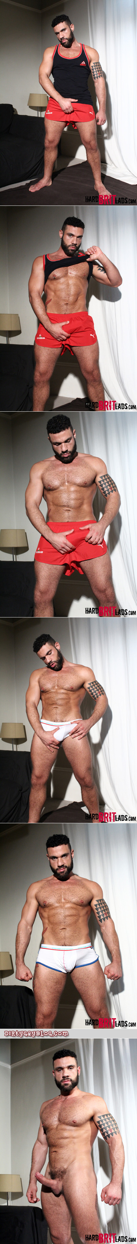 Hairy muscle god in athletic shorts and tight white briefs sporting a hard-on.